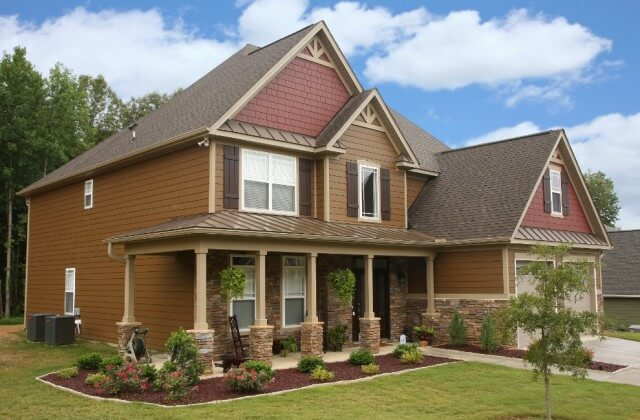 chesnut brown - maroon house color with stone siding